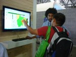 Ashoka at our booth dicussing the EcoCitizen Map he made for Medellin